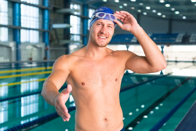 Male swimmer giving his hand