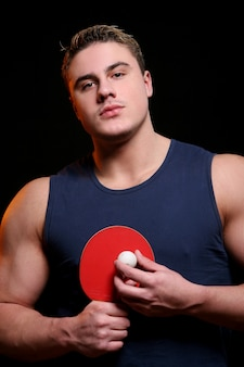 Male table tennis player with ping pong ball