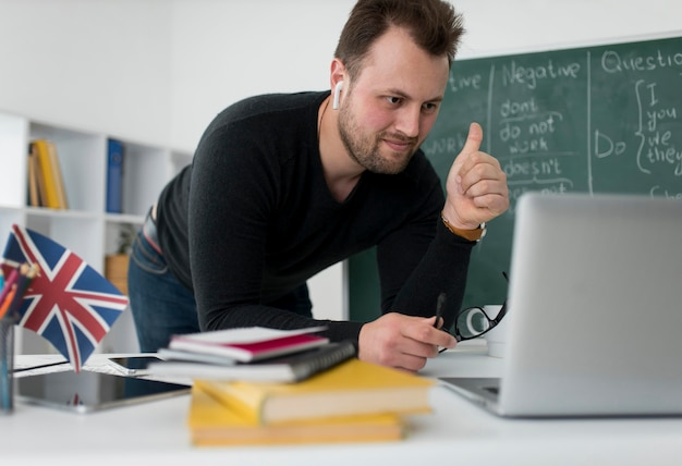 Male teacher doing an english lesson online for his students