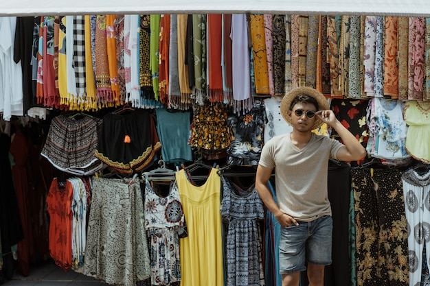 Male tourist try to buy something in souvenir shop