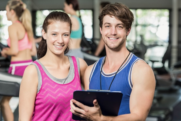 Male trainer discussing about performance in  gym