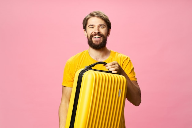 Male traveler with a suitcase in his hands posing in , vacation