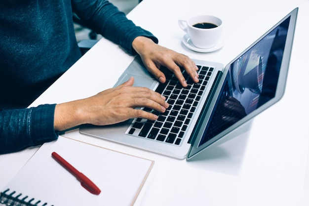 Male using computer laptop in office.business lifestyle and organization concepts