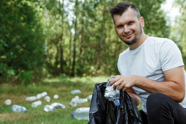 A male volunteer holding a garbage