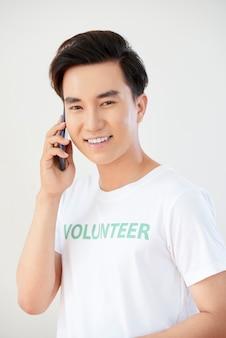 Male volunteer using his phone