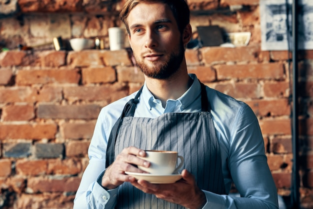 Male waiter apron coffee cup work professional cafe