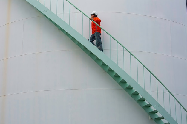 Male walking the stairway inspection visual storage tank oil