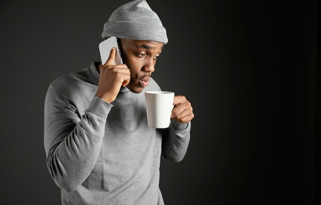 Male wearing cap talking on phone
