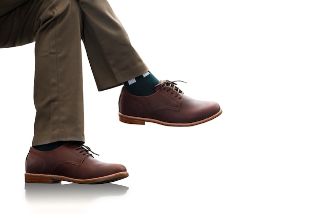 The male wears long pants and brown leather shoes for man collection clothing