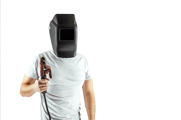 Male welder in a helmet on a white background.