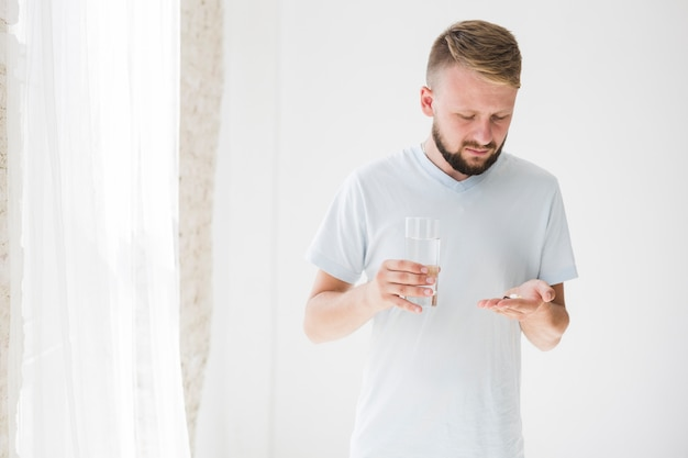 Male with pills in hand