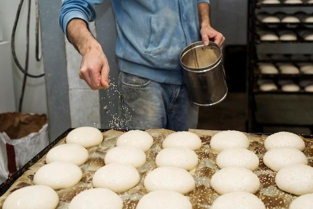 Male worker in a bread factory
