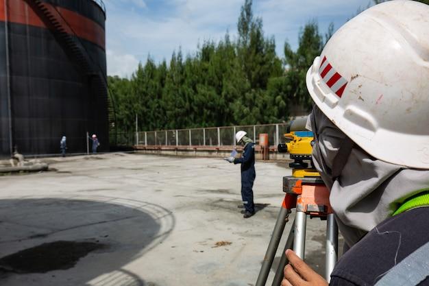 Male worker inspection    survey  level of storage tank