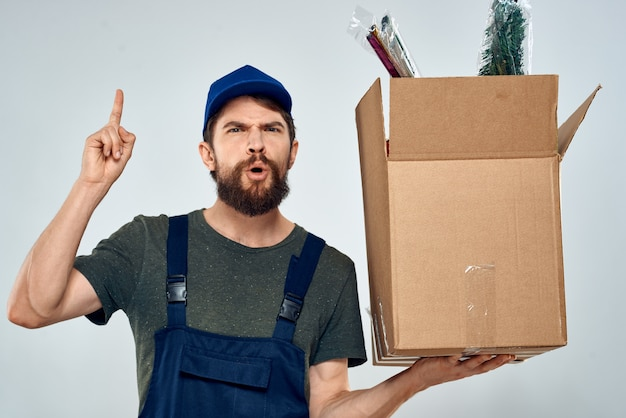 Male worker loading delivery boxes in hands packing