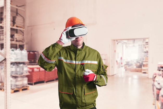 A male worker in uniform using virtual reality glasses, new technology glasses