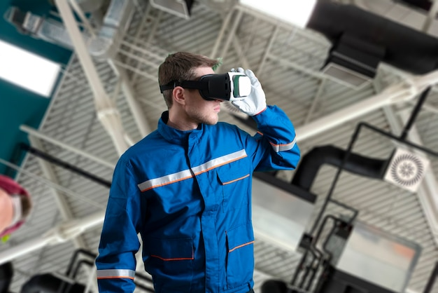 A male worker in uniform using virtual reality glasses new technology glasses