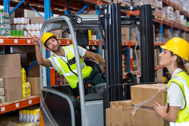 Male worker using forklift