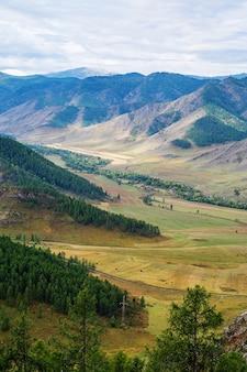 Maly ilgumen river valley snowcapped peak of mount akkem on horizon mountain altai russia