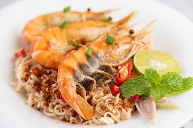 Mama and shrimp on a white plate.