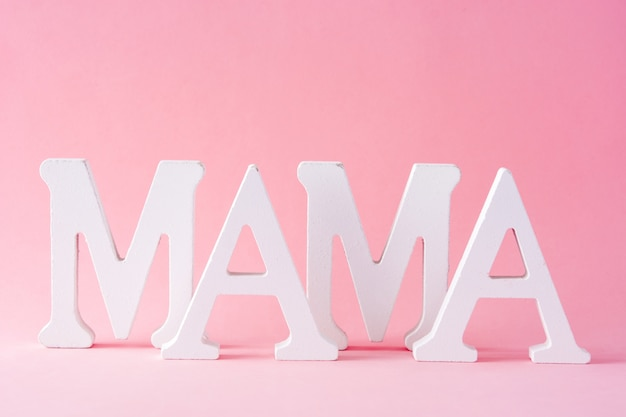 Mama word on pink background mother's day concept