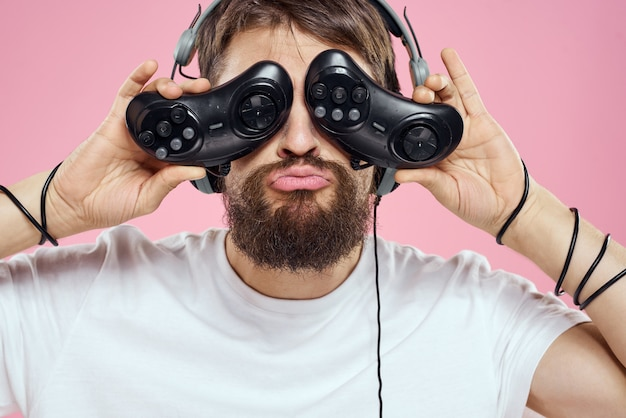 A man in 3d glasses plays a computer game in consoles with joysticks