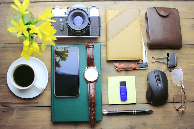 Man accessory on wooden working table background
