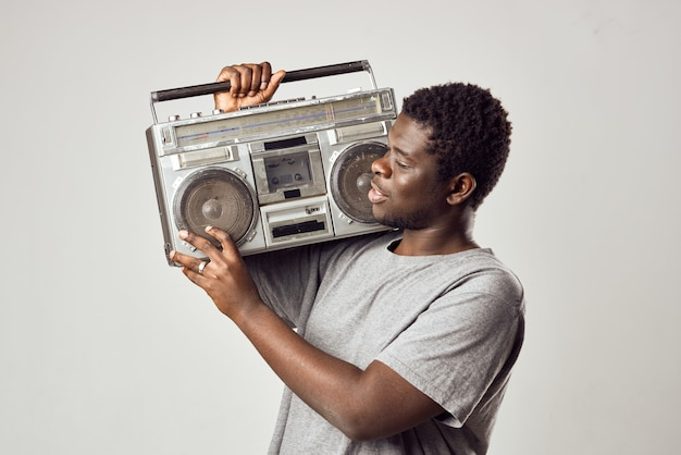 Man of african appearance tape recorder in hands music nostalgia