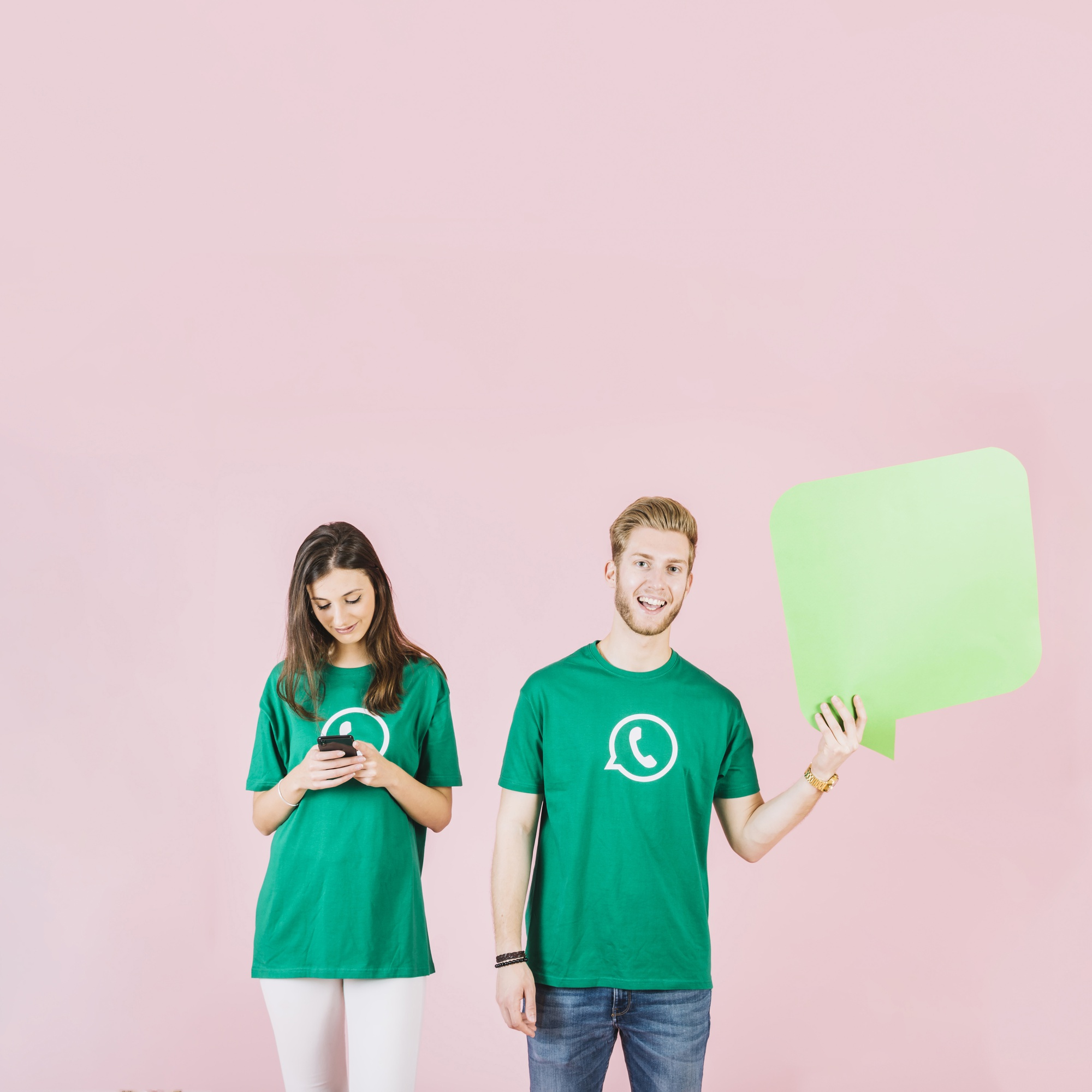 Man and woman holding empty speech bubble and smartphone