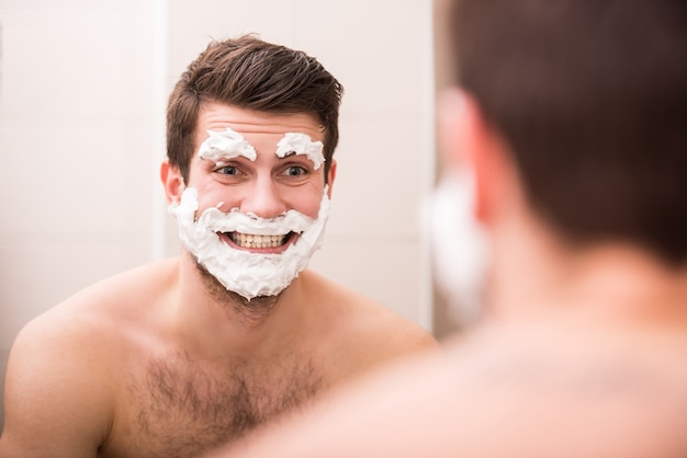 A man applied shaving foam to his face.
