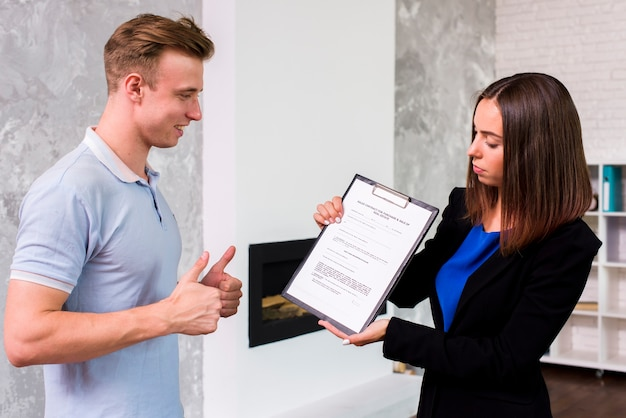 Man approving with a businesswoman