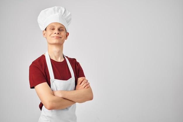 男エプロンキッチンプロの明るい背景シェフ