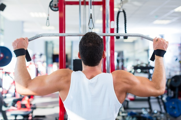 Man at back sport training in fitness gym