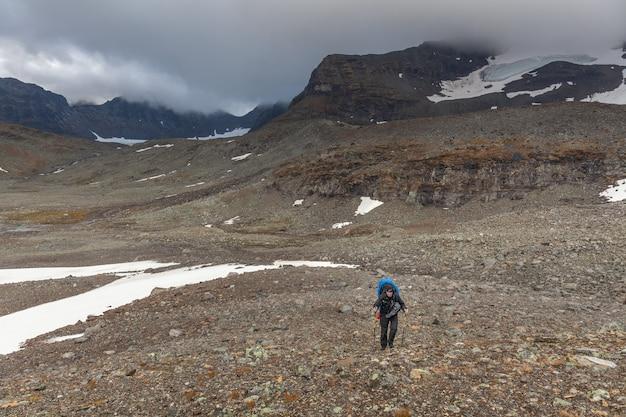 Man backpack hiker at kungsleden trail admiring nature of sarek