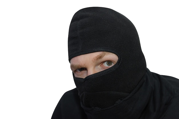 Man in balaclava looks suspiciously close-up portrait isolated
