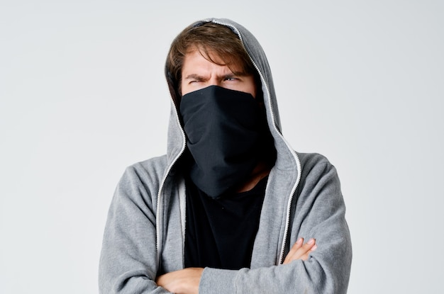 A man in balaklava with a hood anonymity theft neatness to crime