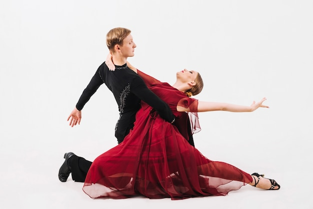 Man in ballroom costume holding woman