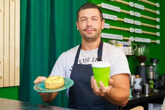 Man barista in a coffee shop portrait