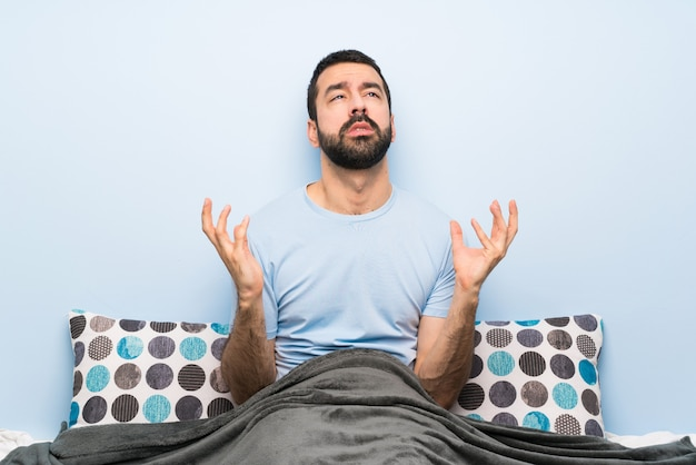 Man in bed frustrated by a bad situation