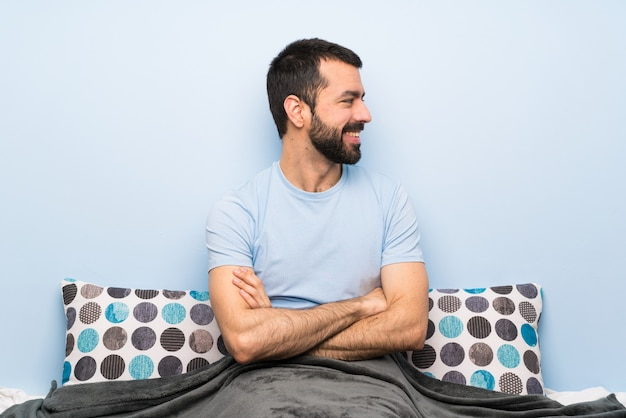 Man in bed in lateral position