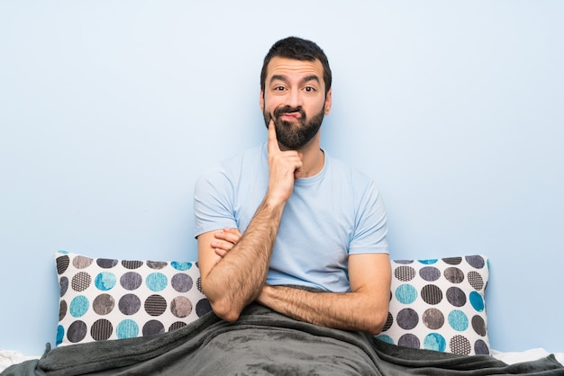 Man in bed looking front