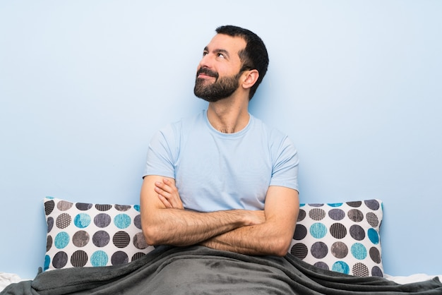 Man in bed looking up while smiling