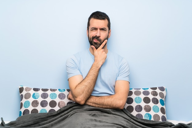Man in bed thinking