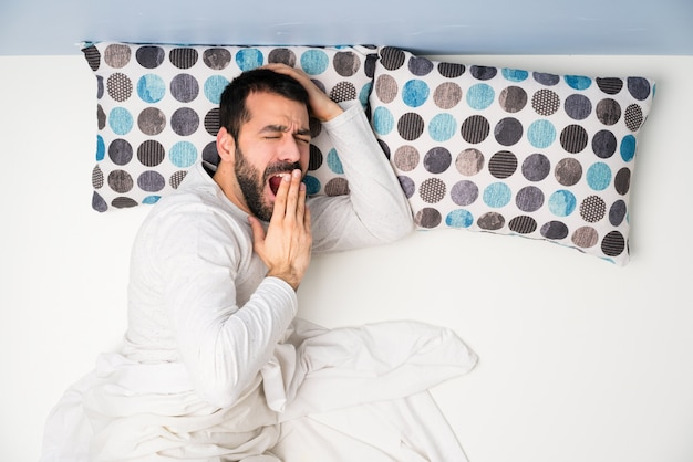 Man in bed in top view