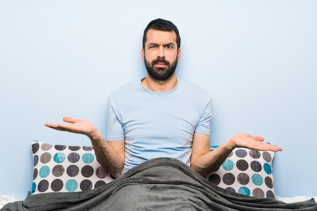 Man in bed unhappy for not understand something