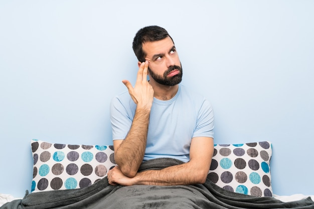 Man in bed with problems making suicide gesture