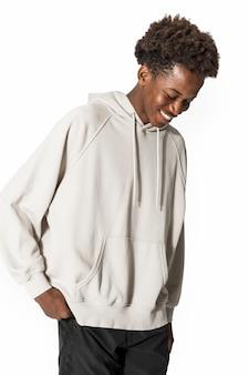 Man in beige hoodie winter youth apparel shoot