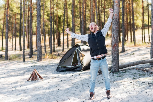 Man being extremely happy in the wilderness