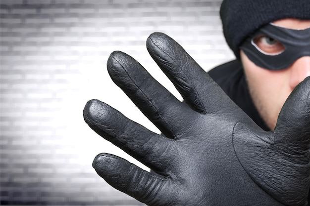 Man in black balaclava on background