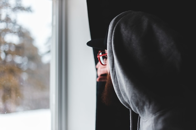Man in black hat and gray hoodie