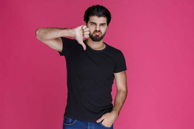 Man in black shirt feeling negative and disappointed about something